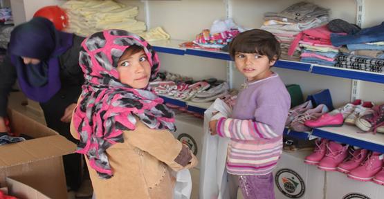 115 Öksüz Mülteci giydirildi