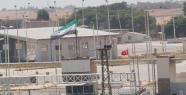 PYD, parasızlıktan ÖSO bayrağı çekmiş