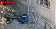 Urfa'da bir apartman kenarında ceset bulundu